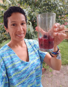 Emily holding glass of fruit and water